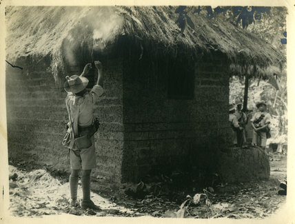 Soldier Repairing Thatch, India