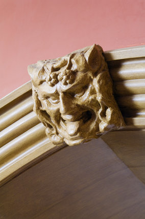 Carved wooden overdoor mask in the Garden Hall at Hughenden Manor, Buckinghamshire, home of prime minister Benjamin Disraeli between 1848 and 1881