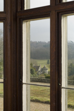 View through the Library window in the new house down to the old Scotney Castle