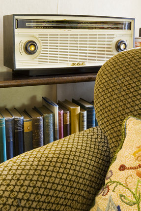 Partial view of an armchair and the GEC (General Electric Co) radio in the Sitting Room at Plas yn Rhiw, Pwllheli, Gwynedd