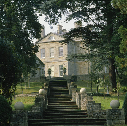 Looking up a tree-lined row of steps to the front of the late-eighteenth century Buscot Park