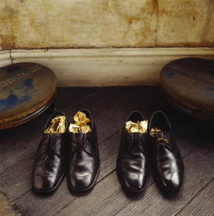 View of two pairs of polished black men's shoes stuffed with paper, found in Walter's Room of Mr Straw's House
