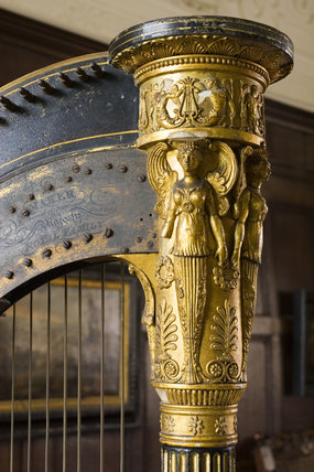 Close view of part of the harp in the Music Room at Westwood Manor, near Bradford-on-Avon, Wiltshire