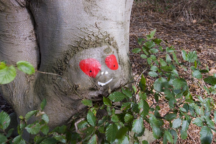 Painted tree trunks in the walks around the site at Sutton Hoo, the Anglo-Saxon royal burial site, Woodbridge, Suffolk