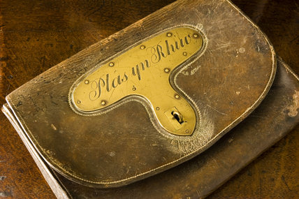 An early-19th-century leather mailbag inscribed