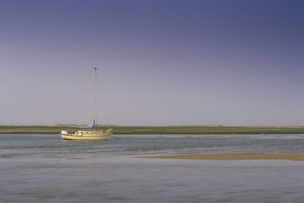 View towards Blakeney Point near Morston Quay with a distant boat on the water
