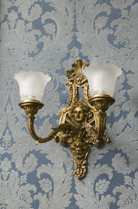 Gilt girandole (wall light) in early eighteenth century Rococo style in the Drawing Room at Hughenden Manor, Buckinghamshire, home of prime minister Benjamin Disraeli between 1848 and 1881