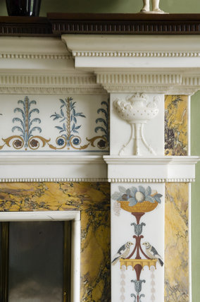 Close view of part of the fireplace in the Library at Hughenden Manor, Buckinghamshire, home of prime minister Benjamin Disraeli between 1848 and 1881