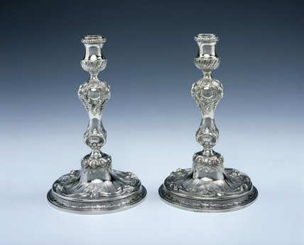 A pair of George II candlesticks by Peter Archambo, 1739, (DUN.S.106) part of the silver collection at Dunham Massey, photographed for the Country House Silver book.