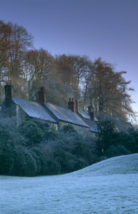 Estate cottages in winter at Stourhead, eighteenth-century landscape garden, Wiltshire