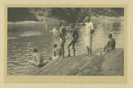 Men washing in the river