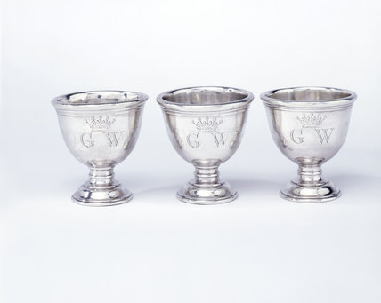Three egg cups from a frame containing ten, by Peter Archambo, 1740/41