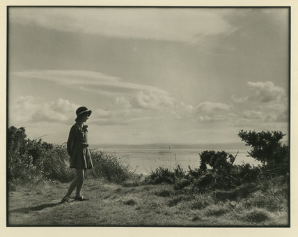 Girl standing by the Shore
