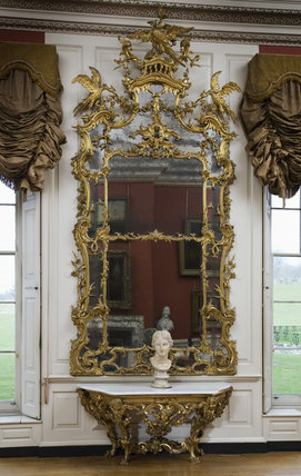 Giltwood pier glass and table (1755-1760) attributed to Whittle & Norman, in the Red Room at Petworth House, West Sussex