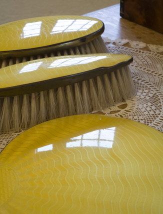 Detail of brushes, part of a dressing table set in a bedroom at Coleton Fishacre, the house designed in 1925 for Rupert and Lady Dorothy D'Oyly Carte at Kingswear, Devon