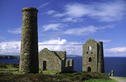 Ruined buildings of the disused tin and copper mines of Wheal Coates at Chapel Porth, Cornwall