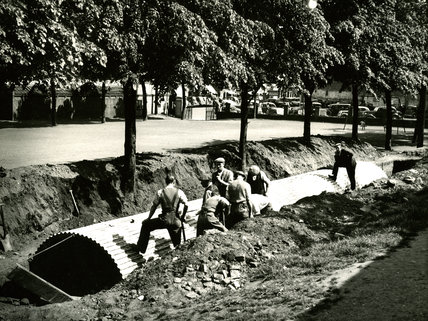 Men laying Corrugated Pipes