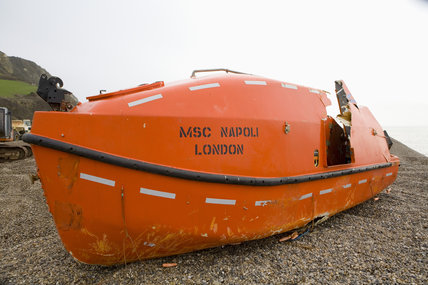 A lifeboat grounded on the beach - The aftermath of the MSC Napoli shedding its cargo, now washed up on the beach at Branscombe, Devon