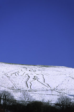 The Cerne Giant on Giant Hill, North of Cerne Abbas, Dorset in snow