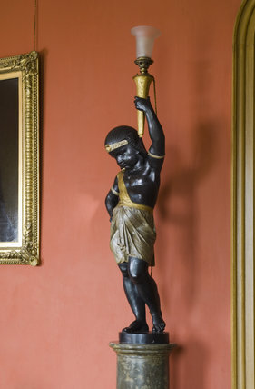 Lamp-holder in the form of an Egyptian boy in the Garden Hall at Hughenden Manor, Buckinghamshire, home of prime minister Benjamin Disraeli between 1848 and 1881