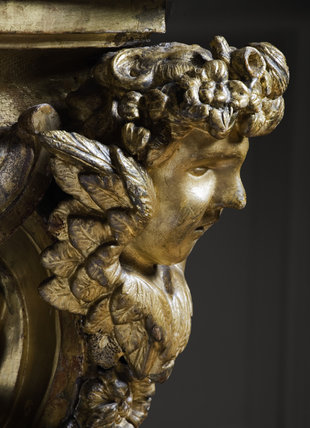 Carved head on the side of the giltwood table (1755-1760) attributed to Whittle & Norman, in the Red Room at Petworth House, West Sussex