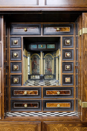 A detail of the late seventeenth-century, Anglo-Dutch, Mass Cabinet with a mirrored recess used by the Host during Mass, at Coughton Court, Warwickshire