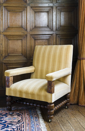 Gold coloured velvet chair in the Dining Room at Coughton Court, Warwickshire