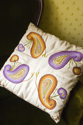 Embroidered cushion in the Yellow Bedroom at Plas yn Rhiw, Pwllheli, Gwynedd