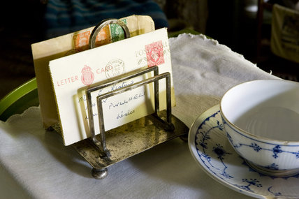 Letters resting in the toast rack, alongside a china teacup and saucer in the Kitchen at Plas yn Rhiw, Pwllheli, Gwynedd
