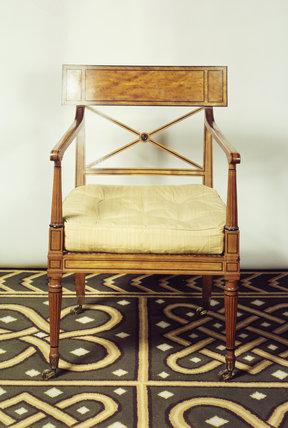 A satinwood elbow chair at Stourhead House with ebony stringing by Thomas Chippendale the Younger