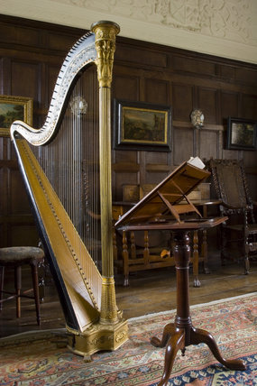 The harp and music stand in the Music Room at Westwood Manor, near Bradford-on-Avon, Wiltshire