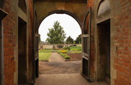 View through the arched gate into the walled garden at Tyntesfield, Wraxall, North Somerset