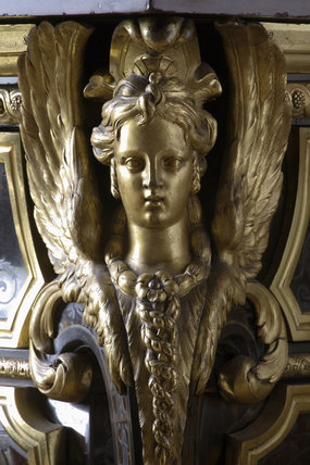 Ormolu winged sphinx on the Boulle commode in the Carved Room at Petworth House, West Sussex