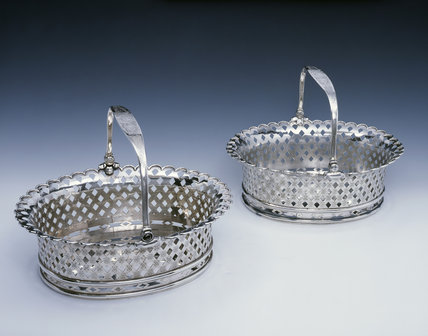 A pair of George II cake baskets by Peter Archambo, 1730/1, (DUN.S.300 & 466), part of the silver collection at Dunham Massey, photographed for the Country House Silver book.