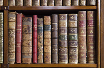 Leather bound books on the shelves in the Library at Hughenden Manor, Buckinghamshire, home of prime minister Benjamin Disraeli between 1848 and 1881