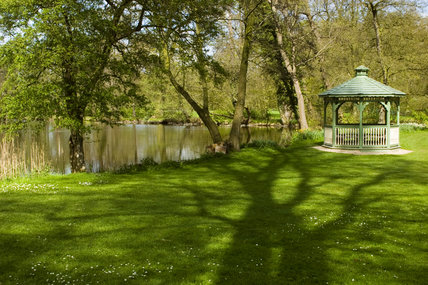 The gazebo next to the lake in the grounds at Coughton Court, Warwickshire