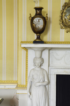 The corner of the late eighteenth-century chimney-piece from Ashburnham Place, Sussex now in the Drawing Room at Hinton Ampner, Hampshire