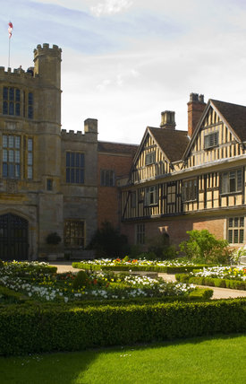 A view of the sixteenth-century North Range, built mostly as lodgings for guests, and part of the Courtyard with the Gate Tower to the left hand side at Coughton Court, Warwickshire