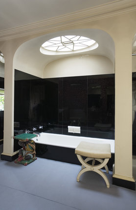 The Bathroom showing the bath in the black-tiled alcove at Hinton Ampner, Hampshire