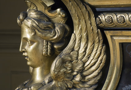 Close view of the face of the sphinx on the Boulle commode in the Carved Room at Petworth House, West Sussex
