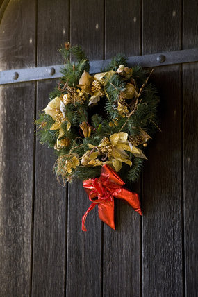 Christmas wreath adorns the wooden door during the Christmas fair at Lacock Abbey, near Chippenham, Wiltshire