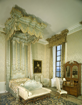 Belton House - The Blue Bedroom showing state bed with blue silk damask hangings, chaise longue and bureau-cabinet dating from c.1715