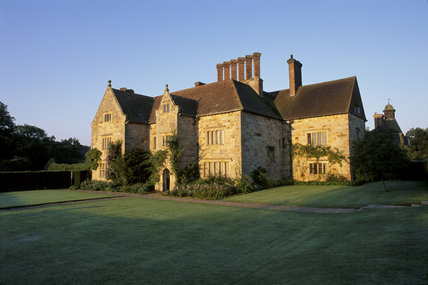 The yellow stone exterior of Bateman's in brilliant sunlight, East Sussex