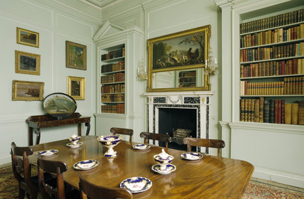 The Green Library with a William IV mahogany dining table and chairs at Mottisfont Abbey, Hampshire