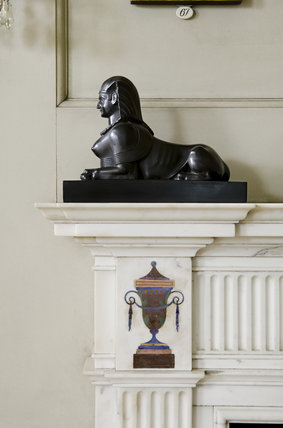 Detail of the black sphinx and corner of the eighteenth-century fireplace by Bossi in the Morning Room at Mottisfont Abbey, Hampshire