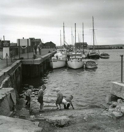 Children Playing at Unidentified Harbour