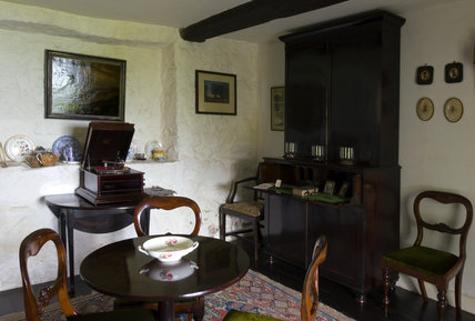 The Parlour at Plas yn Rhiw, Pwllheli, Gwynedd, looking towards the Columbia Grafonola wind-up gramophone and a Regency secretaire