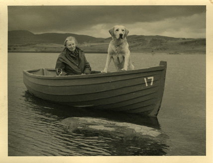 Margaret in Boat with dog