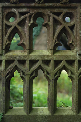 The elaborate tracery of a stone garden seat at Tyntesfield, Wraxall, North Somerset