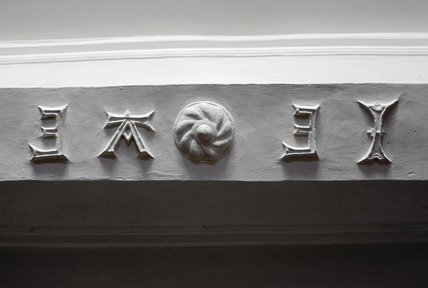 The initial letters of John and Ann Eyre on the plastered cross beam in the Dining Room at Great Chalfield Manor, Wiltshire